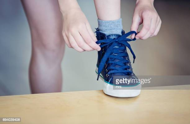child tying shoelaces - shoelace stock pictures, royalty-free photos & images