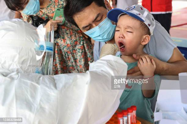 Child undergoes a nucleic acid test for the Covid-19 coronavirus in Xiamen, in China's eastern Fujian province on September 18, 2021. - China OUT /...