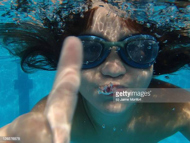 Child underwater with goggles