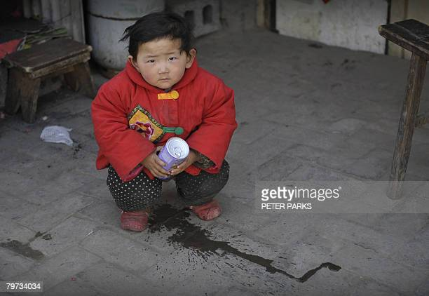 A child urinates in front of his family house in Beijing February 13 2008 Beijingers are spitting and queue jumping less but their manners are still...