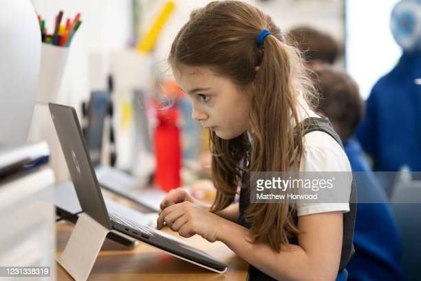 Child uses a laptop at Roath Park Primary School on February 23, 2021 in Cardiff, Wales. Children aged three to seven began a phased return to school...