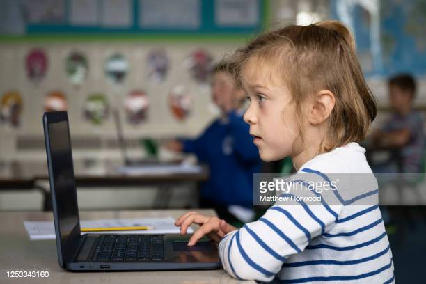 A child uses a laptop in a school classroom at Roath Park Primary School on June 29 2020 in Cardiff Wales Schoolchildren of all years will be able to...