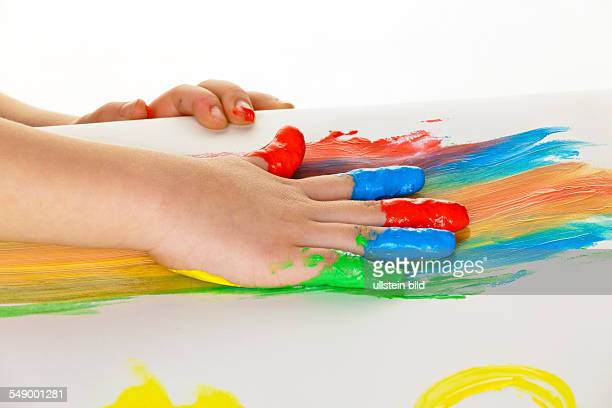 Child uses finger paint