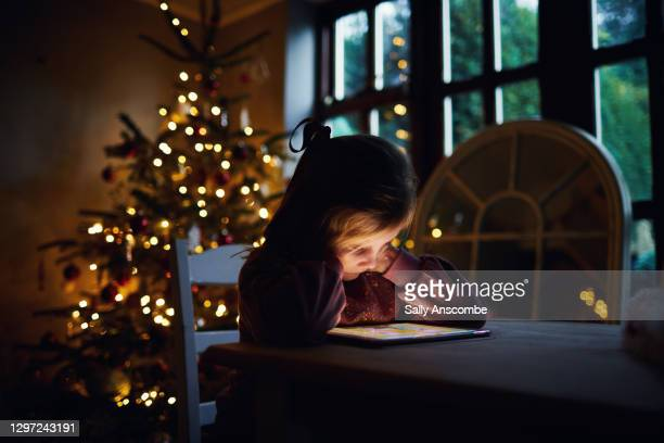 child using a digital tablet - sally anscombe stock pictures, royalty-free photos & images