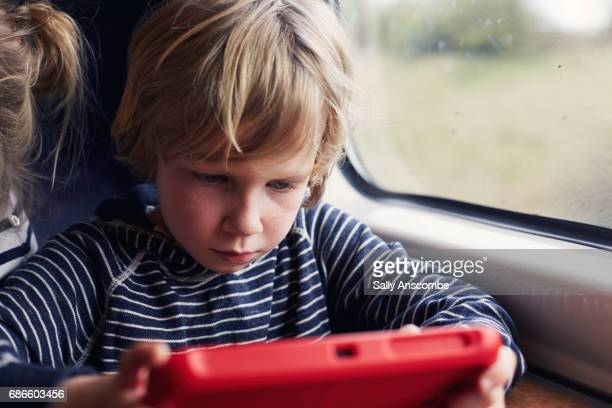 child using a digital tablet - using digital tablet stock photos and pictures
