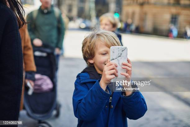 child using a smartphone - photo messaging stock pictures, royalty-free photos & images