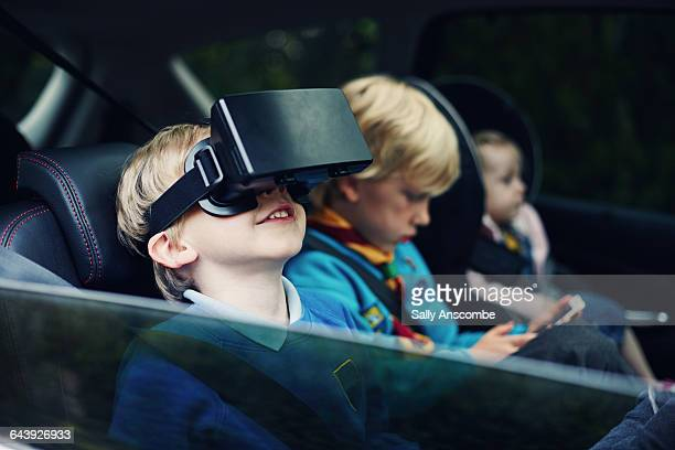 child using a virtual reality headset - family inside car stock photos and pictures