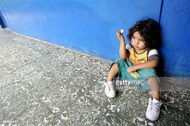 A child victim of the floods at the Nuevo Israel community eats a cookie in a temporary shelter in San Salvador El Salvador 06 October 2005...