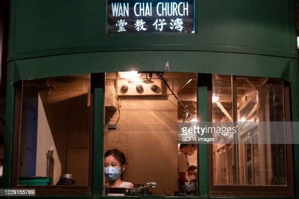 Child visitor is seen in a classic double deck wagon of a tram wearing a face mask during an exhibition at the Hong Kong museum of History. The...