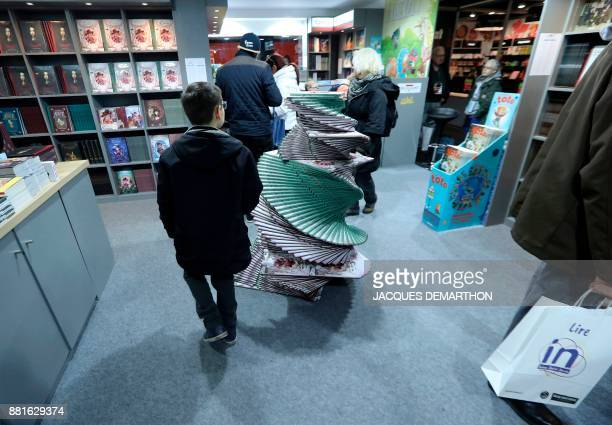 A child visits the Salon du livre et de la presse jeunesse in Montreuil eastern Paris on November 29 2017 DEMARTHON