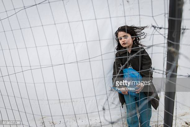 A child waiting chance to cross the GreekMacedonian border The refugees camp on the GreekMacedonian border in Idomeni Macedonia is allowing only...