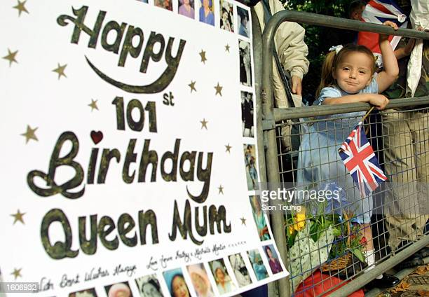 A child waits for Britain''s Queen Mother to appear during celebrations to mark her 101st birthday August 4 2001 in London
