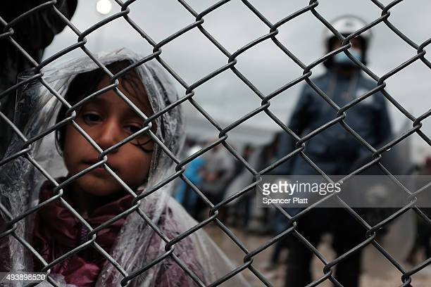 A child waits with her father at the migrant processing center at the increasingly overwhelmed Moria camp on the island of Lesbos on October 23 2015...