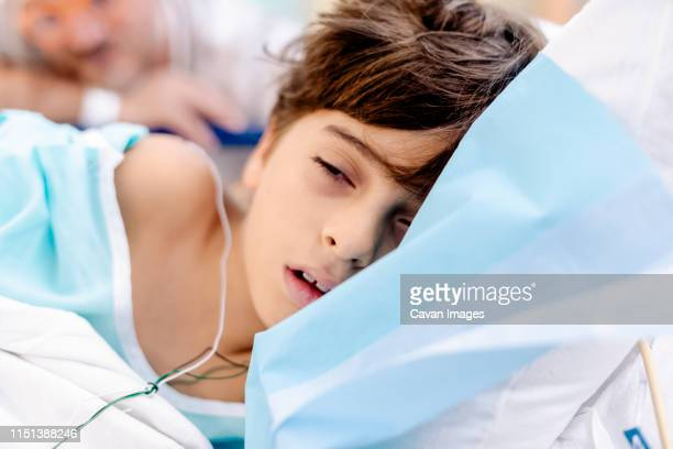 child waking after general anesteshia in hospital bed - hernia stock pictures, royalty-free photos & images