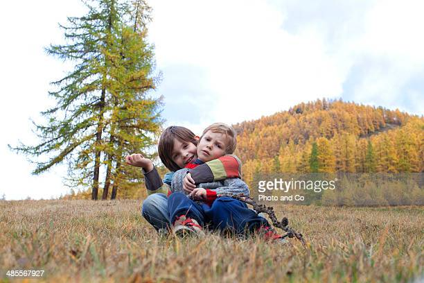 child walking in the mountains in autumn