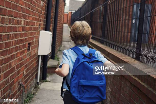 child walking to school - schoolboy stock pictures, royalty-free photos & images