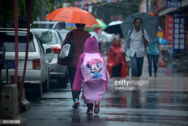 A child walks along a road after school in Beijing on September 2 2014 China tightens school security after a man stabbed three children and a...