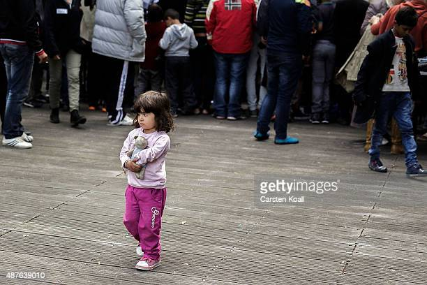 A child walks behind a stand with used clothing in the Horst Korber Sportcenter on September 10 2015 in Berlin Germany Approximately 500 migrants...
