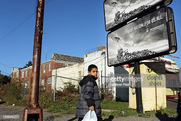 Child walks down a street on October 11, 2012 in Camden, New Jersey. According to the U.S. Census Bureau, Camden, New Jersey is now the most...