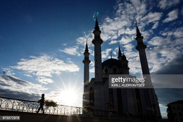 TOPSHOT A child walks in front of the Qol Sharif mosque in the Kazan Kremlin in central Kazan on June 15 during of the Russia 2018 World Cup football...