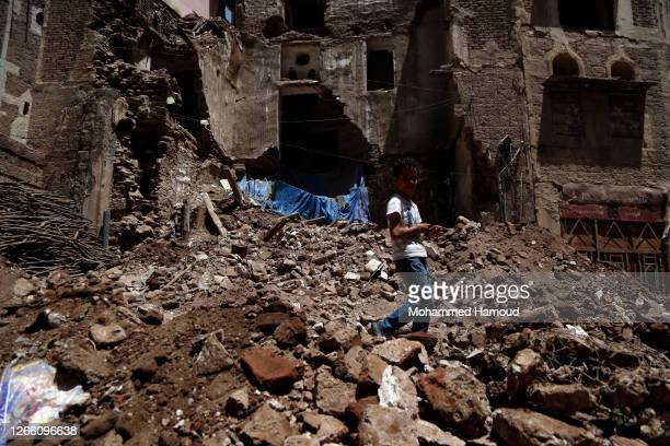 Child walks on the rubble of a historic building after it was collapsed partially due to the heavy rains in the UNESCO World Heritage-listed Old...