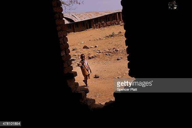 Child walks outside of a school which was destroyed by a recent rock slide on June 22, 2015 in Muhuta, Burundi. The head of Burundi's influential...