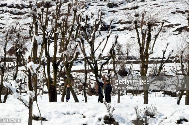 A child walks over snow covered path after fresh snowfall in Daksum about 97 kilometers south of Srinagar city the summer capital of Indiancontrolled...