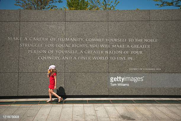A child walks past a quotation by Martin Luther King Jr on the site of the memorial dedicated to the civil rights leader The memorial located on the...