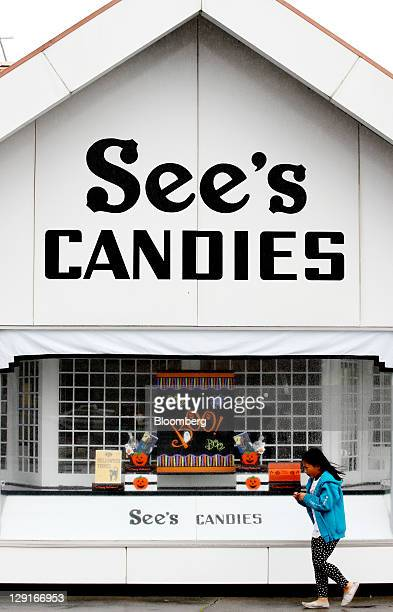 Child walks past a See's Candies Inc. Retail shop next to the company's factory in San Francisco, California, U.S., on Monday, Oct. 10, 2011. See's...