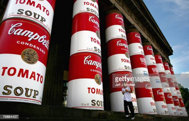 A child walks past giant images of Campbell's soup cans wrapped around the columns of the National Gallery of Scotland to mark an upcoming Andy...