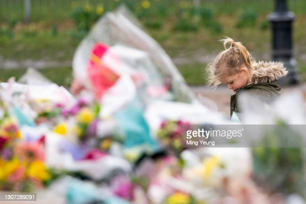 Child walks past tributes to Sarah Everard at the bandstand, Clapham Common, where floral tributes have been building up over the last few days on...