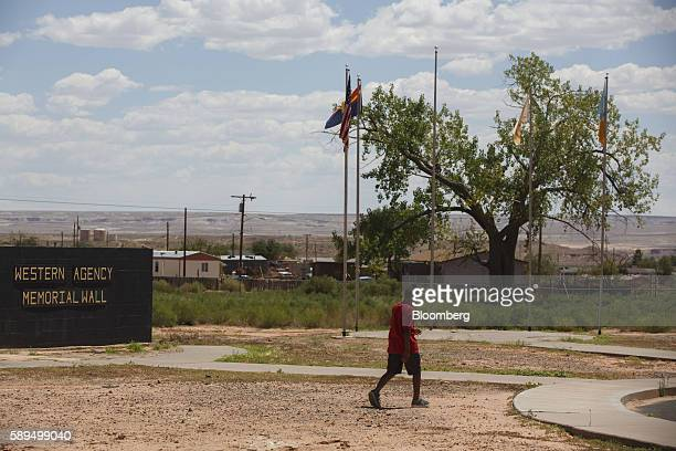 A child walks through a park during a campaign event for Representative Ann Kirkpatrick a Democrat from Arizona not pictured on the Navajo Nation...