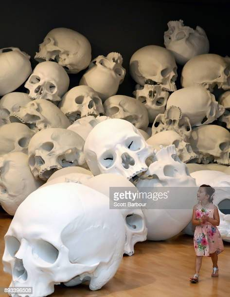 A child walks through artist Ron Mueck's worldpremiere installation 'Mass' consisting of 100 largerthanlife skulls each measuring 15m x 2m during a...