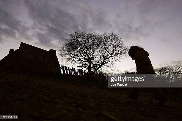A child walks through the 1627 Pilgrim Village at Plimoth Plantation where roleplayers portray Pilgrims seven years after the arrival of the...