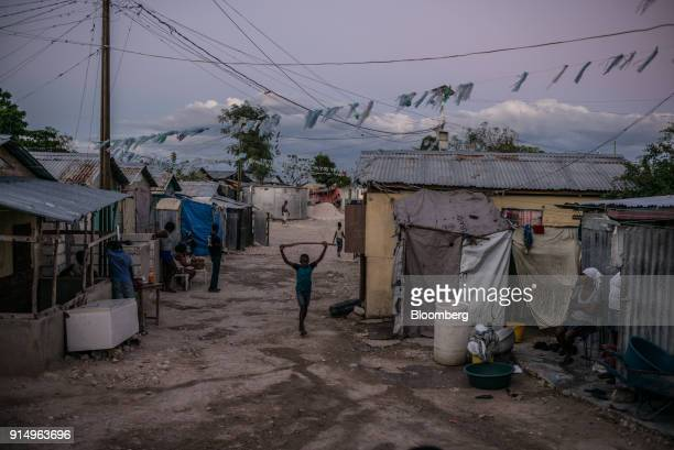 A child walks through the Caradeux refugee camp set up after the 2010 earthquake in PortAuPrince Haiti on Monday Jan 29 2018 Billions of aid poured...