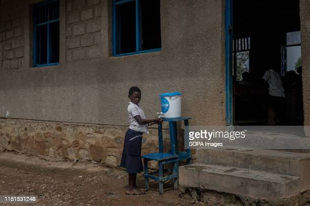Child washes her hands with chlorinated water at a primary school as part of a preventive initiative aimed at halting the spread of Ebola in Beni The...
