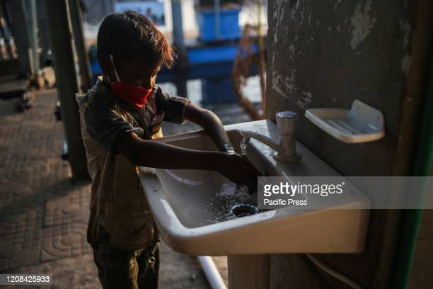 A child washing hands with antibacterial soap at Sadarghat Launch Terminal Total 44 people have been infected by Covid19 in Bangladesh of whom 5 died...