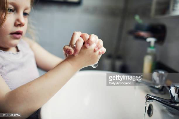 child washing her hands - sally anscombe stock pictures, royalty-free photos & images