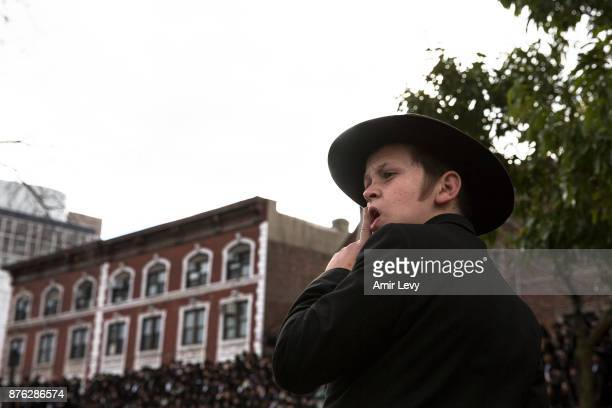 A child watches as Hasidic rabbis prepare to pose a group photo part of the annual International Conference of ChabadLubavitch Emissaries in front of...