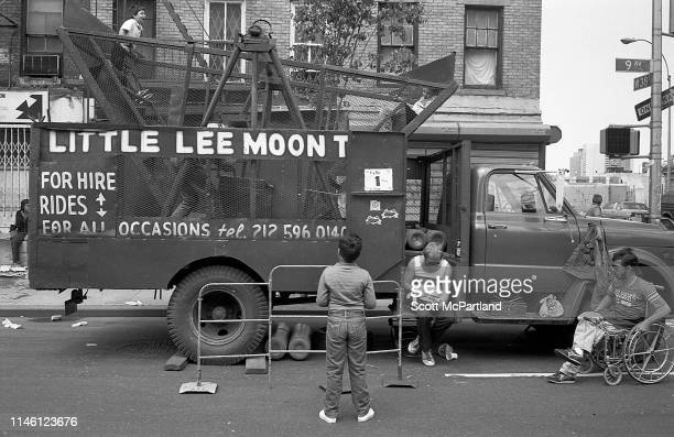 A child watches as others ride a mobile 'pirate ship'style amusement ride parked on the corner of West 38th Street 9th Avenue in Hell's Kitchen New...