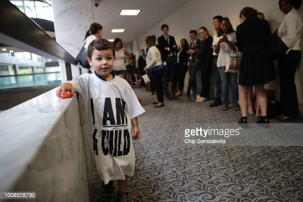 A child watches as representatives from faith and proimmigration groups stand in line to attend a hearing of the Senate Judiciary Committee in the...