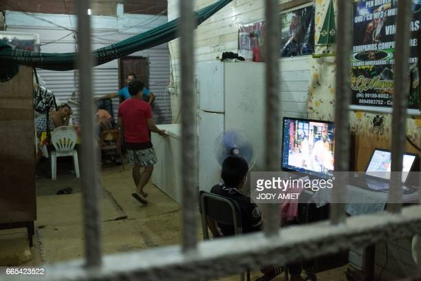 A child watches TV on March 31 2017 in the district MatineLeblond of Cayenne French Guiana Air France canceled its scheduled direct flight of April 7...