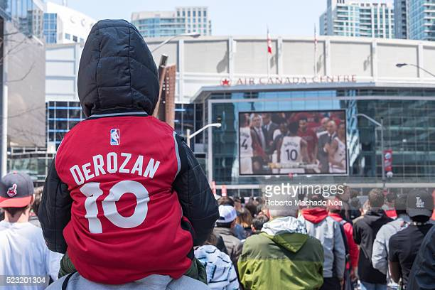 ACC TORONTO ONTARIO CANADA NBA child watching Raptors play off game 1 fans gathered outside the Air Canada Centre to watch in big screen