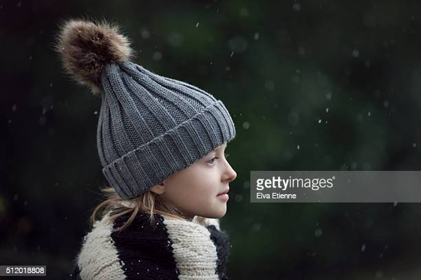 Child watching snowflakes falling