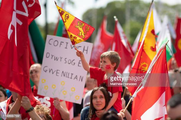 A child waves a flag as thousands take part in the first ever march for Welsh independence from City Hall to the Hayes on May 11 2019 in Cardiff...