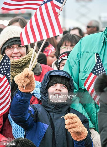 Child waves a flag during the second swearing in of Barack Obama.