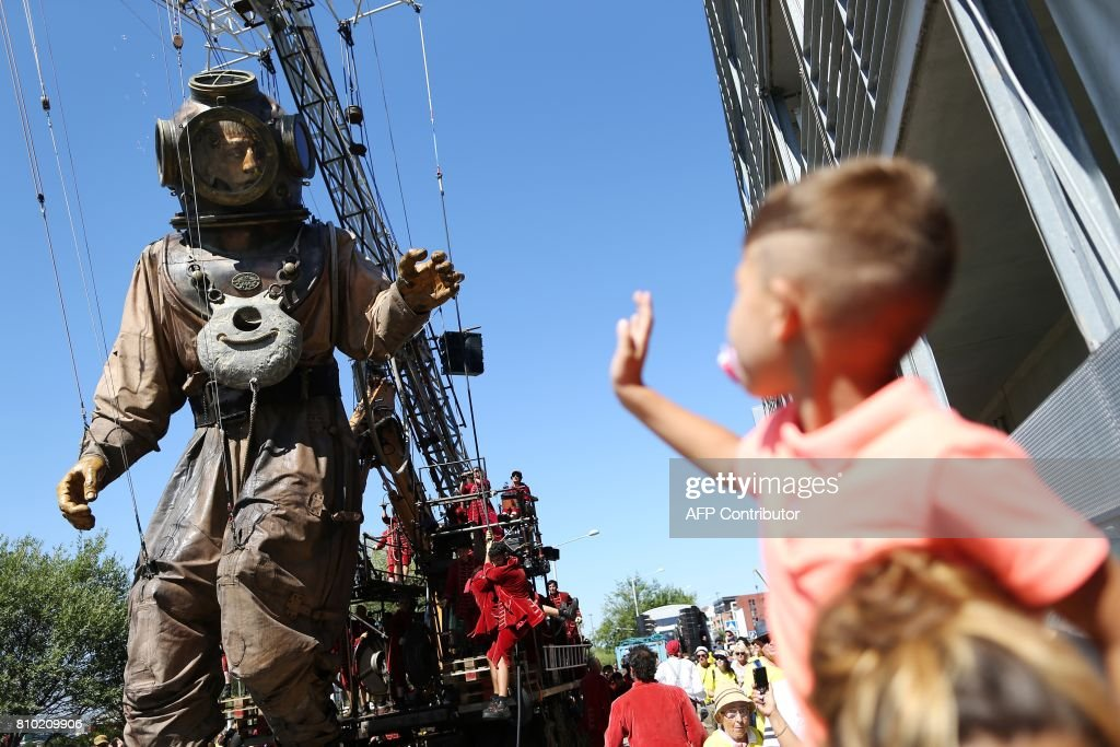 A Child Waves At A Giant Diving Suit Parading In The Streets Of Le Havre,  Northwestern France, On July 7,2017, During The Show Of The French  Mechanical ...