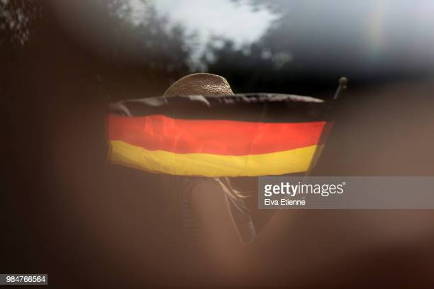 child waving the german national flag outdoors in summer - german flag stock pictures, royalty-free photos & images