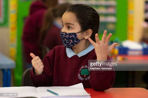Child wearing a face mask counts during a maths lesson at Glan-Yr-Afon primary school on March 3, 2021 in Cardiff, Wales. Children aged three to...