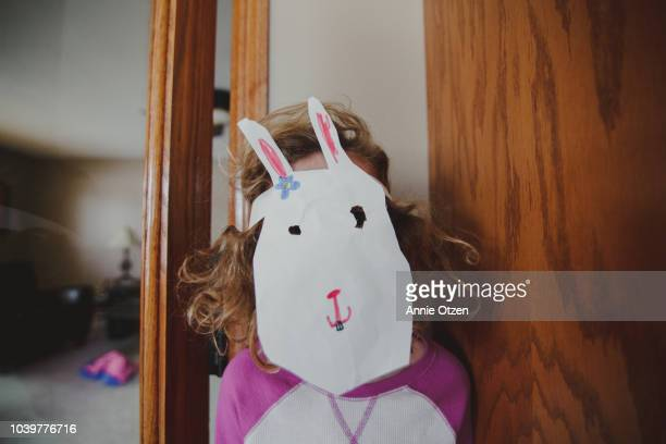 child wearing a home made bunny mask - rabbit mask stock pictures, royalty-free photos & images